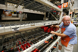 Ed Fluker arranges the last remaining gas containers on otherwise empty shelves at The Home Depot in Lady Lake, FL, USA on Tuesday afternoon, September 5, 2017. The empty shelves beside him are where the generators are typically displayed. The store was out of generators and water early Tuesday. Buyers at the store are preparing for Hurricane Irma. Photo by Stephen M. Dowell/Orlando Sentinel/TNS/ABACAPRESS.COM