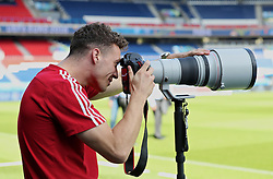 PARIS, FRANCE - Friday, June 24, 2016: Wales' James Chester tries his hand at being a photographer before a training session at the Parc des Princes ahead of the Round of 16 UEFA Euro 2016 Championship match against Northern Ireland. (Pic by David Rawcliffe/Propaganda)
