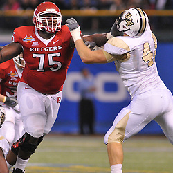 Dec 19, 2009; St. Petersburg, Fla., USA; Rutgers offensive lineman Anthony Davis (75) blocks UCF defensive end David Williams (48) during NCAA Football action in Rutgers' 45-24 victory over Central Florida in the St. Petersburg Bowl at Tropicana Field.
