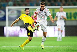 İlkay Gündoğan of Borussia Dortmund vs Manuel Seidl of WAC during football match between WAC Wolfsberg (AUT) and  Borussia Dortmund (GER) in First leg of Third qualifying round of UEFA Europa League 2015/16, on July 30, 2015 in Wörthersee Stadion, Klagenfurt, Austria. Photo by Vid Ponikvar / Sportida