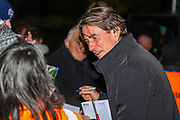 Brentford Manager Thomas Frank signs autographs outside  the stadium ahead of the EFL Sky Bet Championship match between Queens Park Rangers and Brentford at the Kiyan Prince Foundation Stadium, London, England on 28 October 2019.