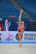 Halkina Katsiaryna during final at ribbon in Pesaro World Cup 28 April 2013. Katsiaryna is a Belarusian rhythmic gymnastics athlete born February 25, 1997 in Minks, Belarus.