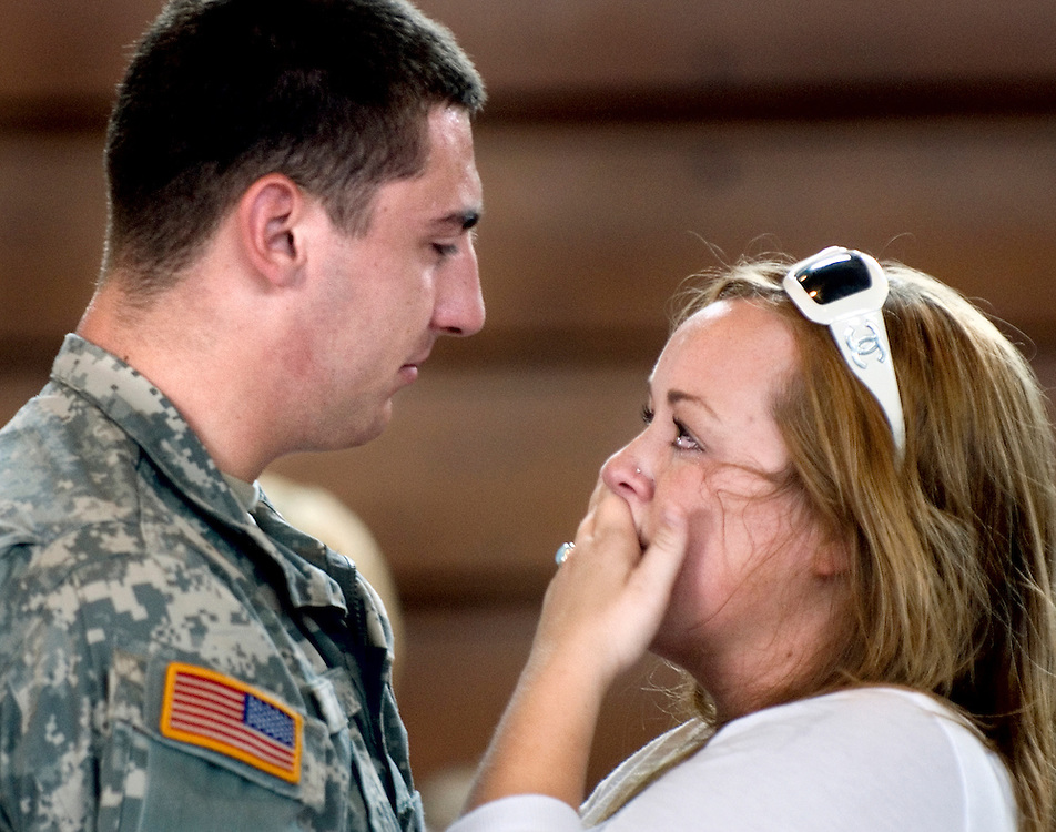 Aaron Moyer, 20, of Fishersville, and his girlfriend Schyler Wilkinson, 19, of Waynesboro say their goodbyes at the Harrisonburg National Guard Armory before Moyer's departure with his unit for deployment in Iraq.