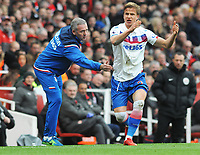 Football - 2017 / 2018 Premier League - Arsenal vs. Stoke City<br /> <br /> Stoke Manager, Paul Lambert, encourages Moritz Bauer at The Emirates.<br /> <br /> COLORSPORT/ANDREW COWIE