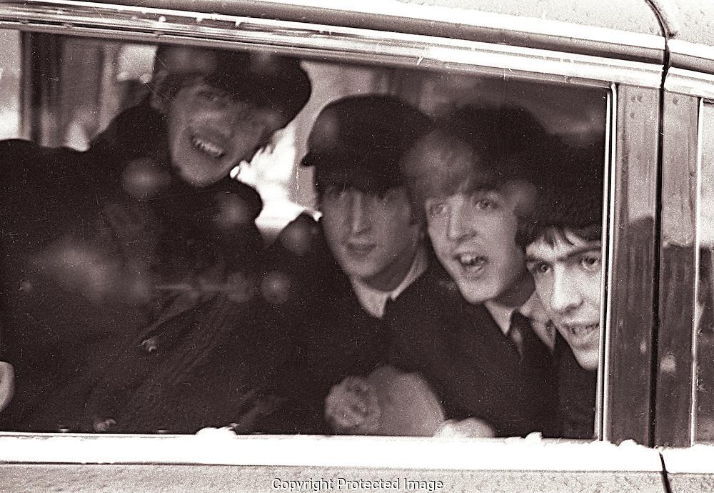 Beatles  on their first trip to Washington, DC February 11, 1964.  Photo by dennis brack