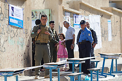 © Licensed to London News Pictures. 30/04/2014. Sulaimaniya, Iraq. An armed guard is seen outside a school being used as a polling station during the 2014 Iraqi parliamentary elections in Sulaimaniya, Iraqi-Kurdistan today (30/04/2014). <br /> <br /> The period leading up to the elections, the fourth held since the 2003 coalition forces invasion, has already seen polling stations in central Iraq hit by suicide bombers causing at least 27 deaths. Photo credit: Matt Cetti-Roberts/LNP