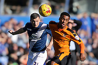 Birmingham City's Paul Caddis and Wolverhampton Wanderers' Nathan Byrne (right) in action