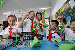June 15, 2018 - Handan, Handan, China - Handan, CHINA-15th June 2018:Pupils attend various folk activities at a primary school in Handan, north China's Hebei Province, June 15th, 2018, marking the upcoming Dragon Boat Festival. (Credit Image: © SIPA Asia via ZUMA Wire)