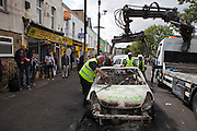 The council remove burnt out vehicles along Clarence road, Pembury estate, Hackney.