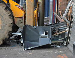 Pictured: The remains of the cash machine at the scene.<br /> <br /> Thieves used a JCB digger to try and steal a cash machine from the wall of a shop in Gorgie Road, Edinburgh in the early hours of Thursday. They fled the scene.<br /> <br /> © Dave Johnston / EEm