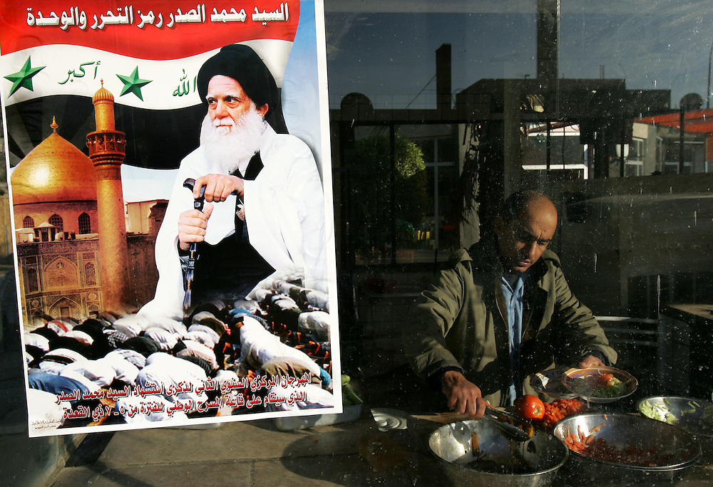 17 December 2004.Baghdad, Iraq.Election campaign posters/Iraq..The streets of Baghdad, Iraq begin to brighten up as posters of political leaders are pasted up in the neighbourhoods where they have or seek support.