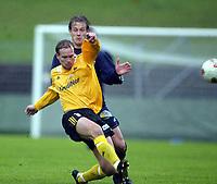 Fotball, 13. mai 2003, NM fotball herrer, Strømsgodset-Bærum,  Bjørn Stephansen, Bærum, mot Kim Larsen, Strømsgodset
