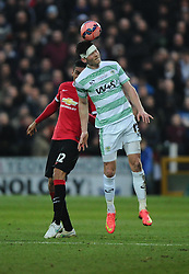 Yeovil Town's Kieffer Moore battles for the high ball with Manchester United's Chris Smalling  - Photo mandatory by-line: Joe meredith/JMP - Mobile: 07966 386802 - 04/01/2015 - SPORT - football - Yeovil - Huish Park - Yeovil Town v Manchester United - FA Cup - Third Round