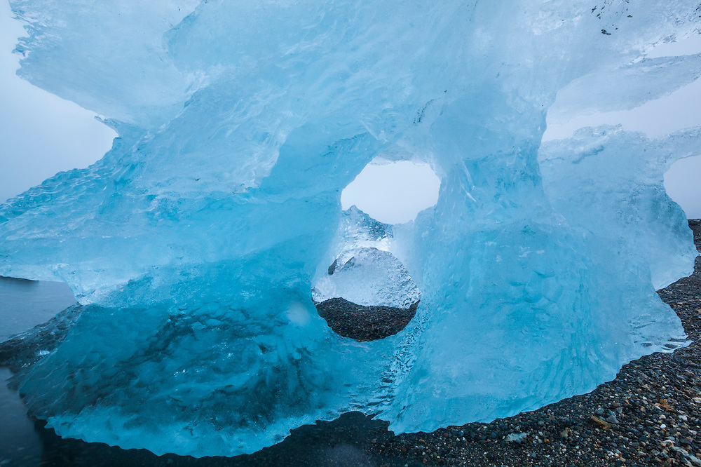 An iceberg, calved by nearby Hansbreen, deposited on the beach by the tide in Hornsund, Svalbard.