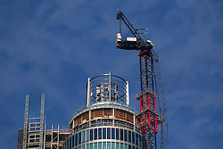 © Licensed to London News Pictures. 17/01/2013. London, UK. The remains of a crane hang from the side of the St George's Wharf development in Vauxhall after being hit by a helicopter in London yesterday (17/01/13). 2 (two) people, including the pilot, died as a result of the incident and a further 11 (eleven) injured after the Augusta 109 helicopter collided with the crane in heavy mist showering wreckage onto cars below. Photo credit: Matt Cetti-Roberts/LNP