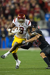 SANTA CLARA, CA - DECEMBER 05:  Wide receiver JuJu Smith-Schuster #9 of the USC Trojans breaks a tackle form cornerback Alijah Holder #13 of the Stanford Cardinal during the third quarter of the Pac-12 Championship game at Levi's Stadium on December 5, 2015 in Santa Clara, California. The Stanford Cardinal defeated the USC Trojans 41-22. (Photo by Jason O. Watson/Getty Images) *** Local Caption *** JuJu Smith-Schuster; Alijah Holder