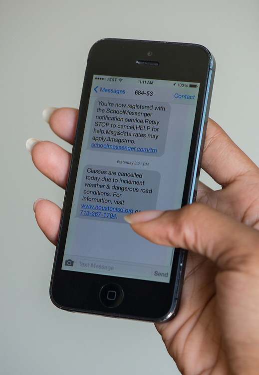 An emergency text is displayed on a smartphone, August 14, 2014.