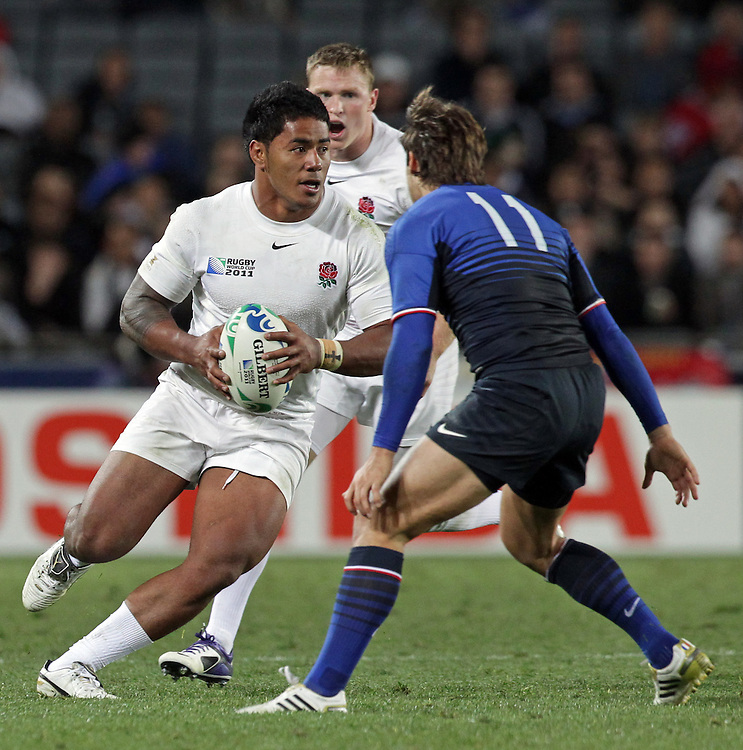 England's Manu Tuilagi is about to be challenged by France's Alexis Palisson during quarter-final 2 match of the Rugby World Cup 2011, Eden Park, Auckland, New Zealand, Saturday, October 08, 2011.  Credit:SNPA / David Rowland