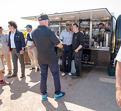 Former US president Barack Obama with Sir Tom Hunter taking a pic, at the kiosk at the 9th hole. playing golf at St Andrews.
