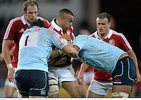 15 June 2013; Simon Zebo, British & Irish Lions, is tackled by Jeremy Tilse, left, and Will Skelton, NSW Waratahs. British & Irish Lions Tour 2013, NSW Waratahs v British & Irish Lions, Allianz Stadium, Sydney, NSW, Australia. Picture credit: Stephen McCarthy / SPORTSFILE