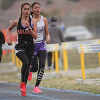 Gallup Bengal Jessica Ramirez laps the competition on her way to a first place finish in the 3200m race Saturday at Zuni High School.