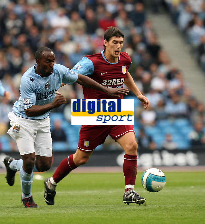 Photo: Paul Greenwood.<br />Manchester City v Aston Villa. The FA Barclays Premiership. 16/09/2007.<br />Man City's Darius Vassell (L09 tussles with Gareth Barry