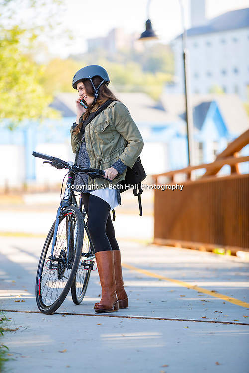 Molly Johnson rides a bike on the Razorback Greenway on Monday, Sept. 29, 2014, in Fayetteville, Arkansas. Photo by Beth Hall