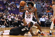 Oct 11, 2017; Phoenix, AZ, USA; Phoenix Suns forward Josh Jackson (20) recovers a loose ball in front of Portland Trail Blazers guard Damian Lillard (0) in the first half at Talking Stick Resort Arena. Mandatory Credit: Jennifer Stewart-USA TODAY Sports