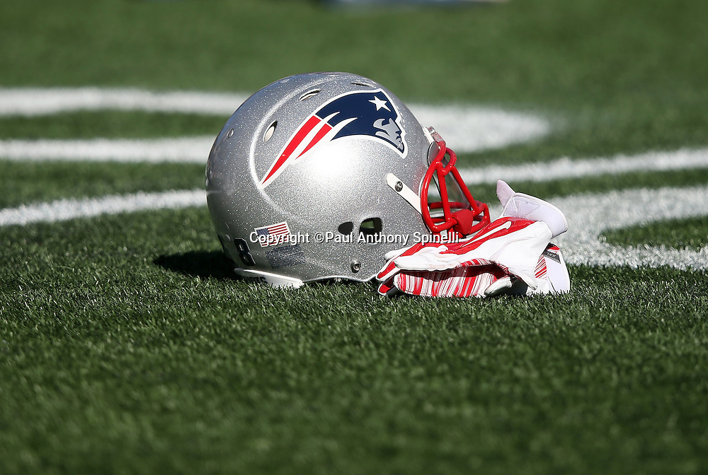 A New England Patriots helmet lies on the turf during pregame player warmups before the 2015 week 9 regular season NFL football game against the Washington Redskins on Sunday, Nov. 8, 2015 in Foxborough, Mass. The Patriots won the game 27-10. (©Paul Anthony Spinelli)