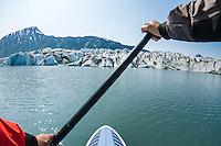 SUP paddling in the lagoon at Bear Glacier.