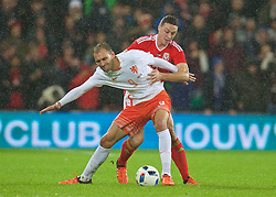 CARDIFF, WALES - Friday, November 13, 2015: The Netherlands' Bas Dost and Wales' James Chester during the International Friendly match at the Cardiff City Stadium. (Pic by David Rawcliffe/Propaganda)
