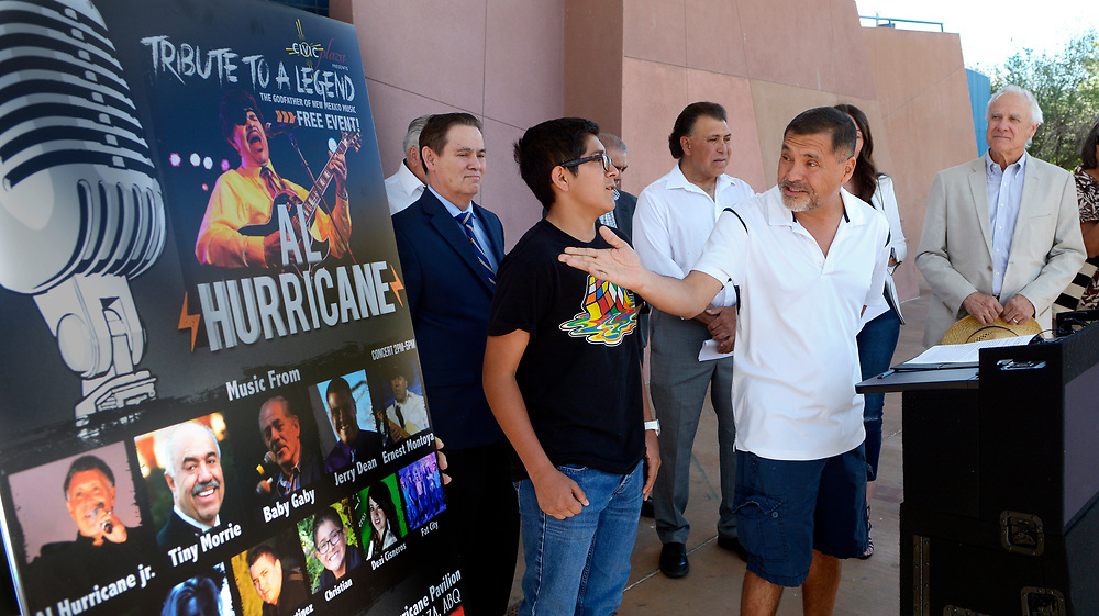 """gbs042317m/ASEC -- Jerry Dean Sanchez, son of Al Hurricane Sr., center gestures while, from left, City Councilor Ken Sanchez, Christian Sanchez, Al Hurricane Sr.'s grandson, Al Hurricane Jr. and City Councilor Isaac Benton listen at a press conference announcing a Tribute Concert for Al Hurricane Sr. and the renaming of the stage at Civic Plaza as  """"Al Hurricane Sr. Pavillion at Civic Plaza"""" on Sunday, April 23, 2017. (Greg Sorber/Albuquerque Jounal)"""