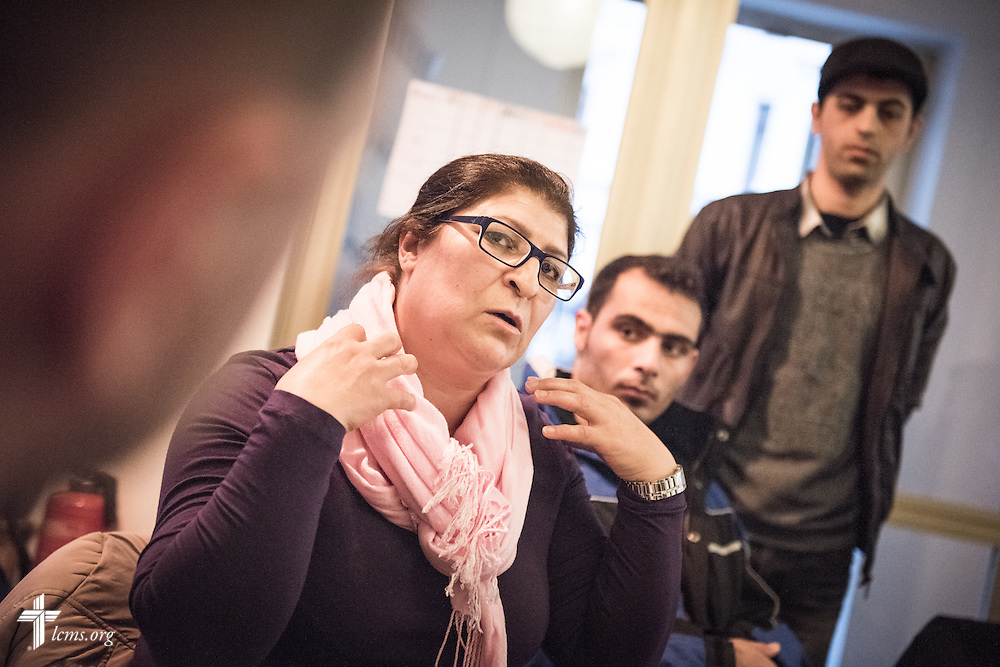 An Iranian Christian refugee talks with the Rev. Markus Fischer, pastor of the Evangelisch-Lutherische St. Trinitatisgemeinde, a SELK Lutheran church in Leipzig, Germany, during a Bible study for Iranian and other refugees on Friday, Nov. 13, 2015, near the church in Leipzig. LCMS Communications/Erik M. Lunsford