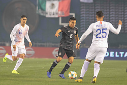March 22, 2019 - San Diego, CA, U.S. - SAN DIEGO, CA - MARCH 22: Mexico forward Rudolfo Pizarro (20) brings the ball up against Chile forward Ivan Morales (25) during the International match between the Mexico National Team and Chile on March 22, 2019 at SDCCU Stadium in San Diego, CA.(Photo by Alan Smith/Icon Sportswire) (Credit Image: © Alan Smith/Icon SMI via ZUMA Press)