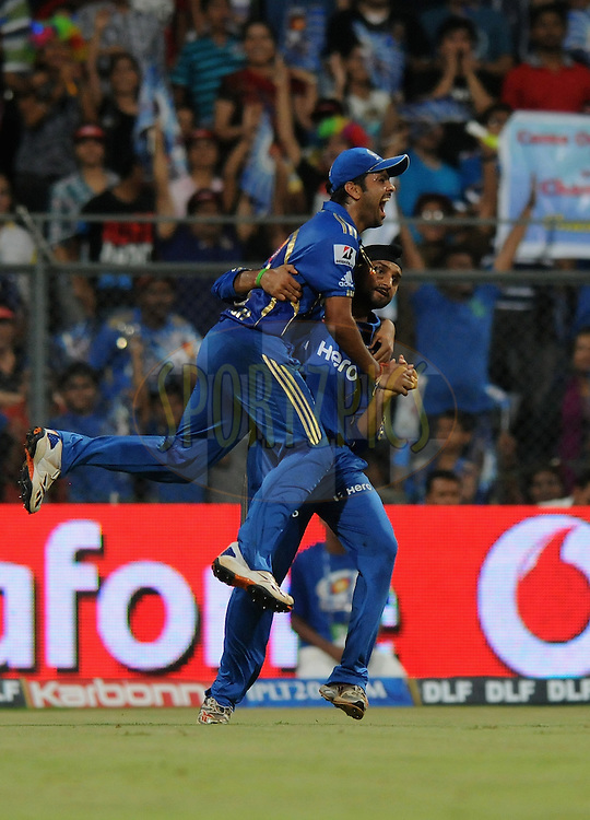 R P Singh of Mumbai Indians celebrate the wicket of Cameron White of Deccan Chargers with captain Harbhajan Singh during match 40 of  the Indian Premier League ( IPL) 2012  between The Mumbai Indians and the Deccan Chargers held at the Wankhede Stadium in Mumbai on the 29th April 2012..Photo by Pal Pillai/IPL/SPORTZPICS.