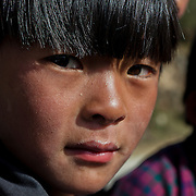 Portrait of a Bhutanese girl from a village of central Bhutan, Trongsa, Bhutan, Asia