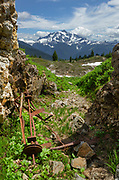 Rusting mining equipment, Yellow Aster Butte Basin. Mount Shuksan is in the distance. Mount Baker Wilderness, North Cascades Washington