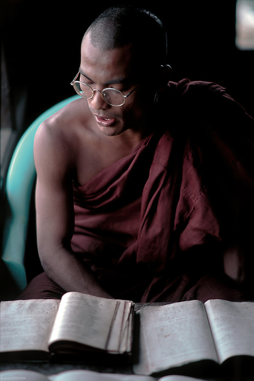— A monk recites Buddhist texts for students to repeat and memorize.
