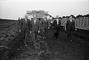 23/09/1963<br /> 09/23/1963<br /> 23 September 1963<br /> Minister sees advances in peat productivity by Bord na Mona at Timahoe, Co. Kildare. Picture shows Mr Dermot C. Lawlor, (left) Managing Director, Bord na Mona walking with the Minister for Transport and Power, Mr Erskine Childers in front of a turf loader at Timahoe turf works, during the minister's end of season visit to Bord na Mona installations.