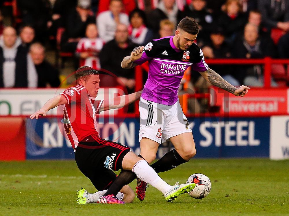 Michael Doyle of Sheffield United tackles Ben Gladwin of Swindon Town   - Photo mandatory by-line: Matt McNulty/JMP - Mobile: 07966 386802 - 07/05/2015 - SPORT - Football - Sheffield - Bramall Lane - Sheffield United v Swindon Town - Sky Bet League One