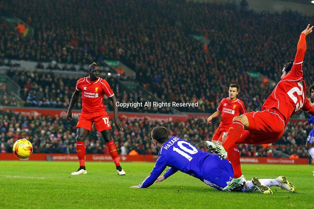 20.01.2015.  Anfield, Liverpool, England. Capital One Cup Semi Final. Liverpool versus Chelsea. Liverpool midfielder Emre Can fouls Chelsea midfielder Eden Hazard to concede the penalty