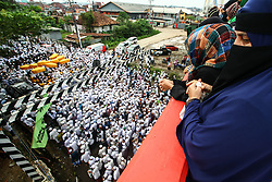 April 28, 2019 - Palembang, South Sumatra, Indonesia - PALEMBANG, INDONESIA - APRIL 28 : Thousands of pilgrims walked to the tomb during the  Kubro Pilgrimage tradition at Palembang on April 28, 2019 in South Sumatra province, Indonesia. The Kubro Pilgrimage tradition is carried out a week before the holy month of Ramadan by visiting the tomb of the founder of the Palembang Darussalam Sultanate, pilgrims come from Indonesia, Malaysia, Singapore and Turkey. (Credit Image: © Sijori Images via ZUMA Wire)