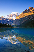 Dawn light on Mount Edith Cavell from Cavell Lake, Jasper National Park, Alberta, Canada