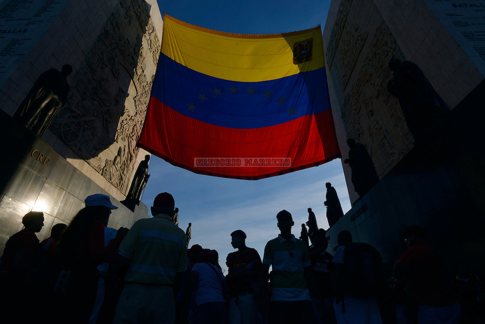 CARACAS - MARCH 07, 2012: Thousands of people make kilometric lines hoping to access the chapel where body of President Hugo Chavez remains who died on March 5 victim of cancer who suffered for two years. (Photo by Gregorio Marrero/LatinContent/Getty Images)