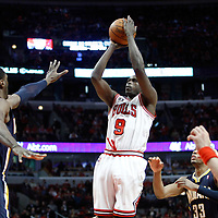 CHICAGO, IL - APR 18: Luol Deng #9 of the Chicago Bulls shoots the ball during game 2 of the Eastern Conference First Round at the United Center on April 18, 2011 in Chicago, IL. NOTE TO USER: User expressly acknowledges and agrees that, by downloading and or using this photograph, User is consenting to the terms and conditions of the Getty Images License Agreement. Mandatory Credit: 2011 NBAE (Photo by Chris Elise/NBAE via Getty Images)