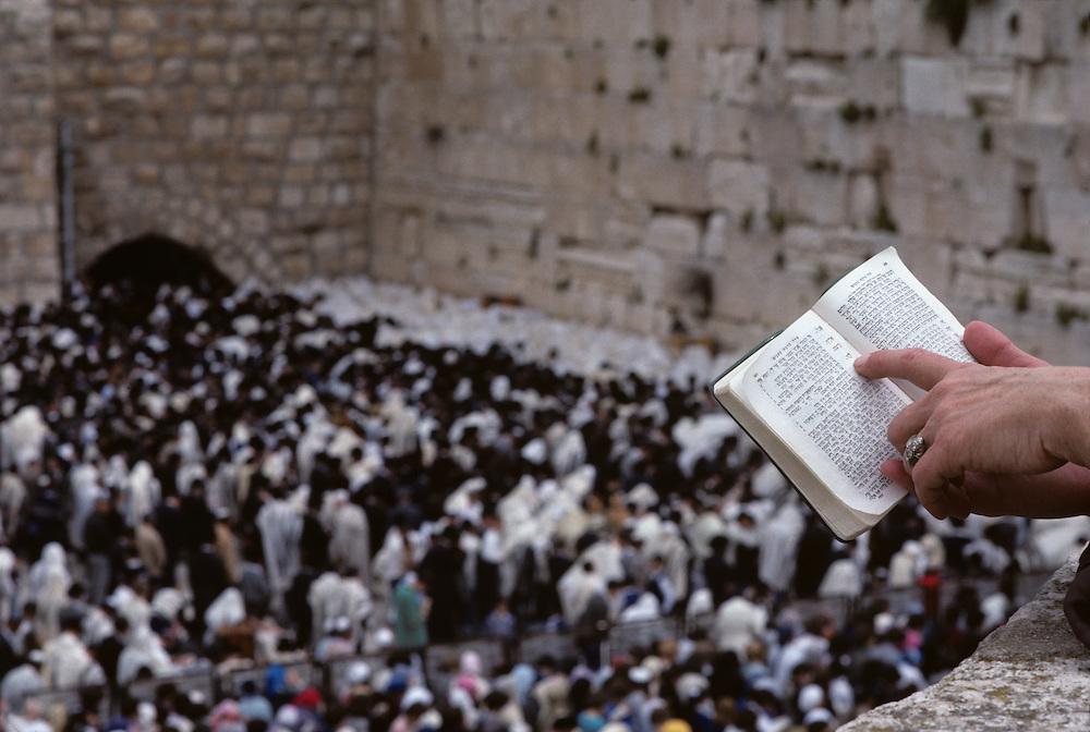 Israel, Jerusalem, Crowds pray at Western Wall during celebration of Passover on spring morning