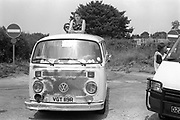 Man and woman standing up in an open top Volkswagen van, Volkswagen van, Glastonbury, Somerset, 1989