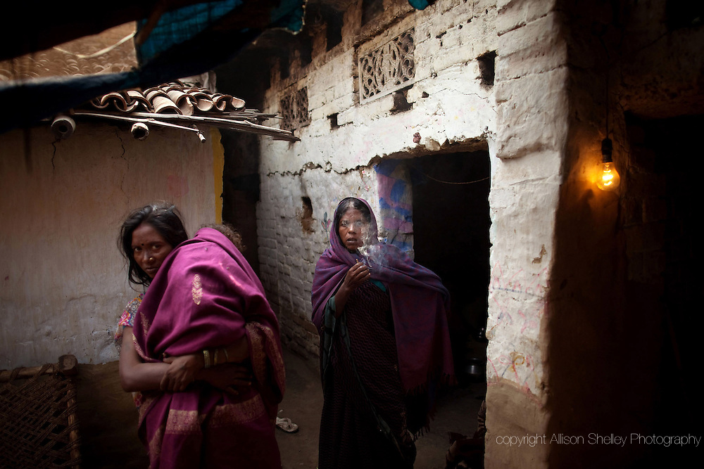 "Kunti Devi, center, and her daughter-in-law mourn the death of Kunti's 16-year-old daughter Mamta at their home in the Motibigha village, Bihar, India.  Mamta died nine days before of severe eclampsia after delivering a stillborn child. Because she had not had her ""gauna""-- or final marriage ceremony-- her parents refused to acknowledge her pregnancy and she received no prenatal care."