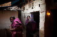 """Kunti Devi, center, and her daughter-in-law mourn the death of Kunti's 16-year-old daughter Mamta at their home in the Motibigha village, Bihar, India.  Mamta died nine days before of severe eclampsia after delivering a stillborn child. Because she had not had her """"gauna""""-- or final marriage ceremony-- her parents refused to acknowledge her pregnancy and she received no prenatal care."""