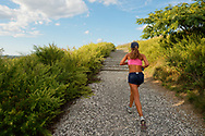 South Merrick, New York, USA. Runner on Norman J Levy Park and Preserve Trail